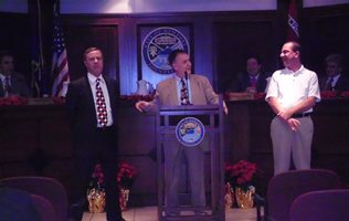 Mayor Peluso (center) recognizes City Attorney Dan Braun (left) and County PVA Dan Braun (right)